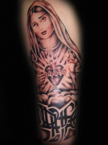 Jimmy Johnson original tattoo. Virgin Mary Tattoo